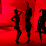 Silhouettes of three slim posturing girls